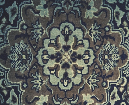 Photo for Old worn carpet, burned canvas  as floor cover.  Flowers in textile. - Royalty Free Image