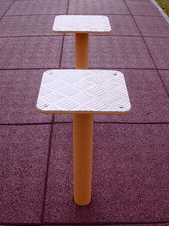 Foto de Outdoor public gym. Street workout and horizontal bar on safety flexible ground. - Imagen libre de derechos