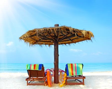 Foto de Beach chairs with umbrella.  Koh Chang, Thailand - Imagen libre de derechos