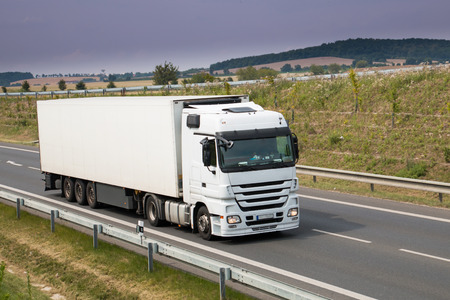 Photo for Heavy white truck with trailer on new road - Royalty Free Image