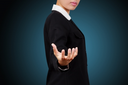 Asian business woman. Showing her empty hands.