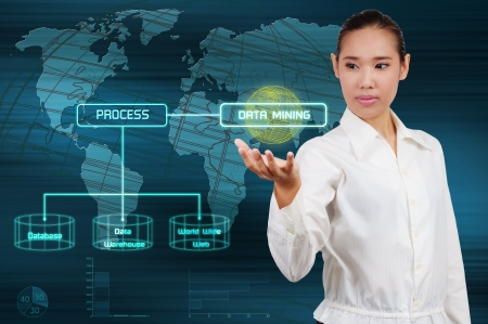 Foto de Data mining concept - business woman show virtual screen - Imagen libre de derechos