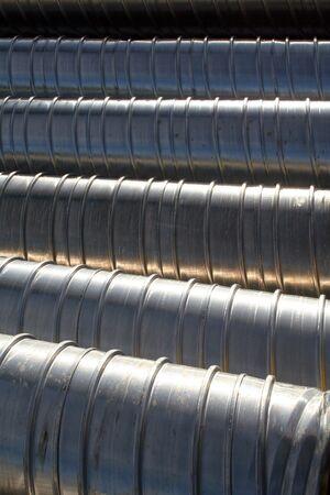 Metallic reinforced undergound tubing awaiting installation, texture