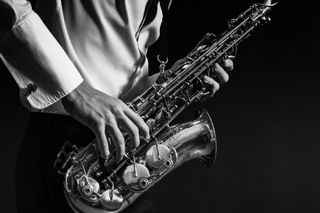 Photo for A man plays the saxophone close up. - Royalty Free Image