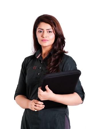 cofident businesswoman holding laptop isolated on white
