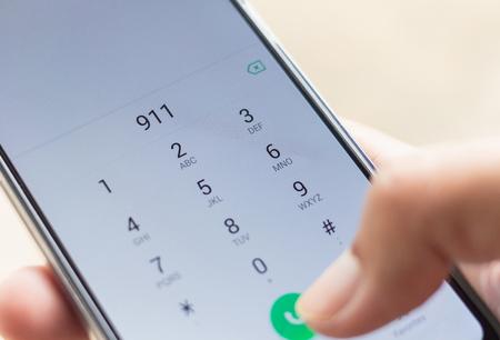 Foto de Emergency and urgency, dialing 911 on smartphone screen. Shallow depth of field. - Imagen libre de derechos