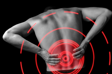 Photo for Acute pain in a male lower back, monochrome  image, pain area of red color - Royalty Free Image