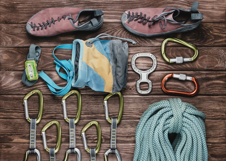 Foto de Equipment for climbing sport on wooden background, top view. - Imagen libre de derechos
