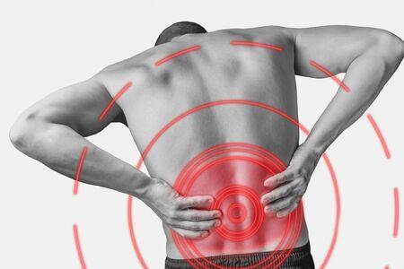 Foto de Acute pain in a male lower back. Monochrome image, isolated on a white background. Pain area of red color. - Imagen libre de derechos