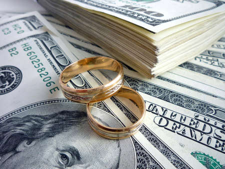 Gold wedding rings on the money
