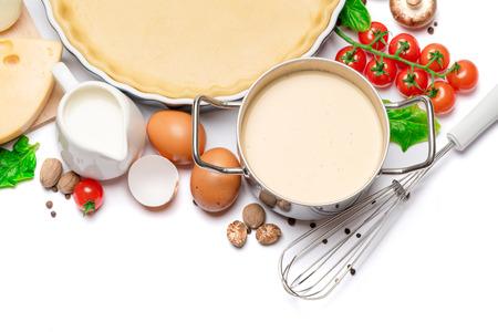 Photo pour shortbread dough for baking quiche tart in baking form and ingredients - image libre de droit