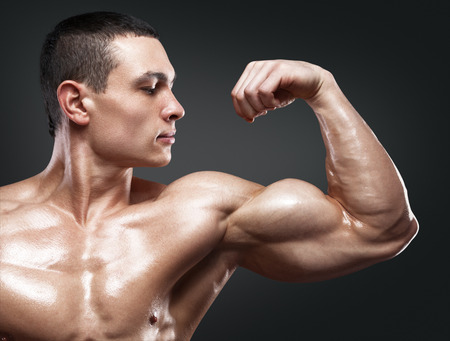 Photo for Close-up of a power fitness man's hand. Strong and handsome young bodybuilder demonstrate his muscles and biceps - Royalty Free Image