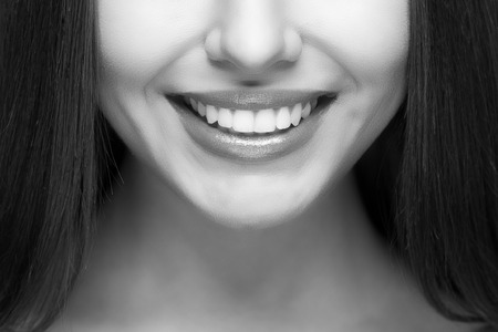 Foto per Beautiful woman smile. Teeth whitening. Dental care. - Immagine Royalty Free