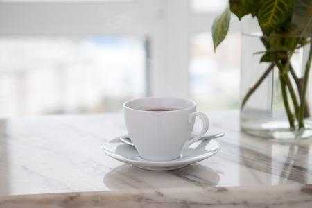 Foto de cup of coffee on marble table - Imagen libre de derechos