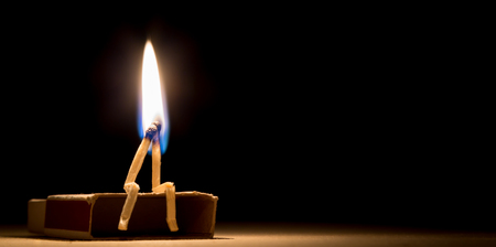 Photo for two matches in flame as a metaphor of togertherness friendship and love - Royalty Free Image