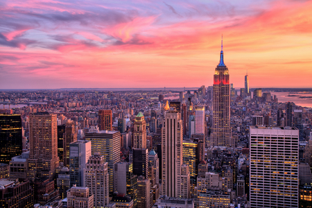 Foto de New York City Midtown with Empire State Building at Amazing Sunset - Imagen libre de derechos