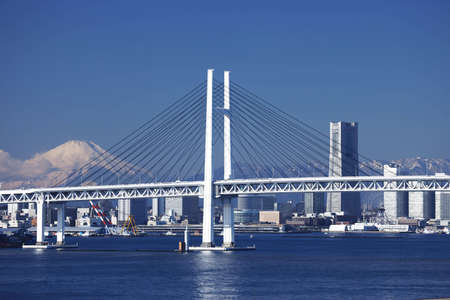 Yokohama Bay Bridge, Mt. Fuji, and a building
