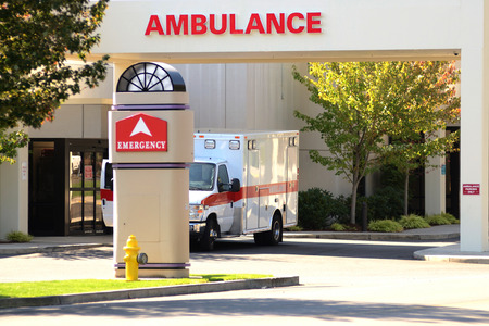 Ambulance sitting at the door of an emergency room at a hospital