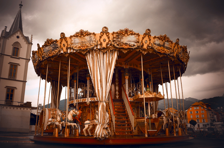 Photo for Creepy dark carousel with a cloudy sky background - Royalty Free Image