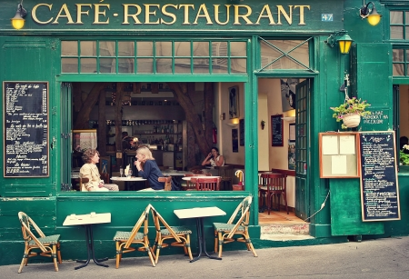 Photo for PARIS - JULY 08  Two women sitting on open terrace in typical Parisian cafe  Restaurants, bars and coffee shops on sidewalks are very popular with parisians and tourists visiting Paris, France on July 08, 2007  - Royalty Free Image