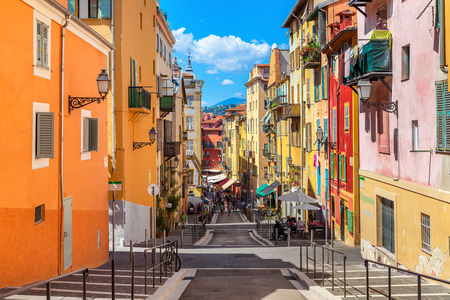 Photo for NICE, FRANCE - AUGUST 23, 2014: Narrow street in old tourist part of Nice - fifth most populous city and one of the most visited cities in France, receiving 4 million tourists every year. - Royalty Free Image
