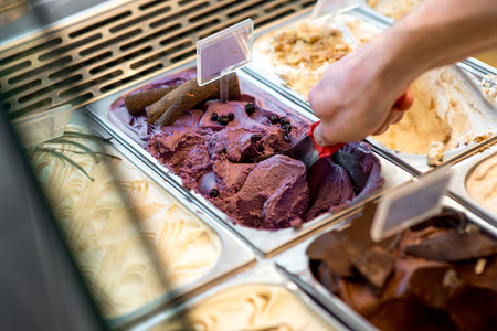 Photo for Picking ice cream from trays in the pastry shop - Royalty Free Image