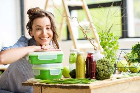 Photo for Woman with lunch boxes - Royalty Free Image
