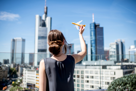 Photo for Woman with toy airplane in Frankfurt - Royalty Free Image