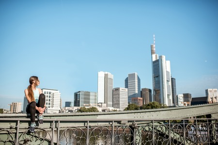Photo for Woman exercising in Frankfurt city - Royalty Free Image