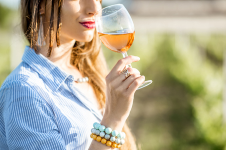 Photo for Woman tasting wine outdoors - Royalty Free Image