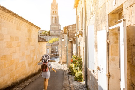 Photo for Woman tarveling in Saint Emilion village, France - Royalty Free Image