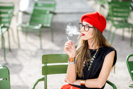 Photo for Woman smoking outdoors - Royalty Free Image