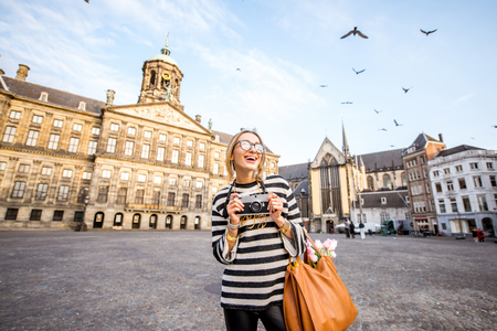 Photo for Woman traveling in Amsterdam city - Royalty Free Image