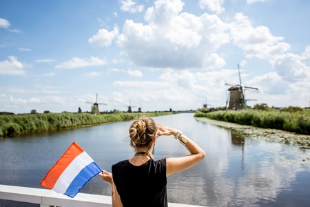 Foto de Woman near the old windmills in Netherlands - Imagen libre de derechos