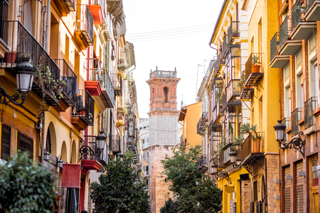 Foto de Street view with beautiful old buildings and saint Bartolomeu tower in Valencia, Spain - Imagen libre de derechos
