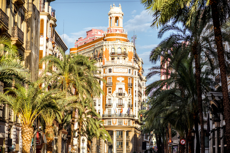 Foto de Street view with beautiful luxurious building and palm trees in Valencia city during the sunny day in Spain - Imagen libre de derechos