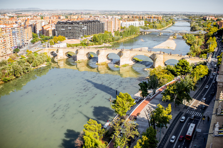 Photo for Aerial cityscape view on Elbe river with stone bridge in Zaragoza city in Spain - Royalty Free Image
