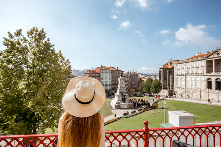 Photo pour Woman in hat looking on the city square with statue of Prince Henry in Porto, Portugal - image libre de droit