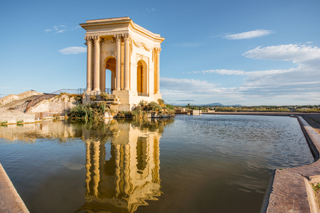 Photo for View on the water tower in Peyrou garden with beautiful water reflection during the morning light in Montpellier city in southern France - Royalty Free Image