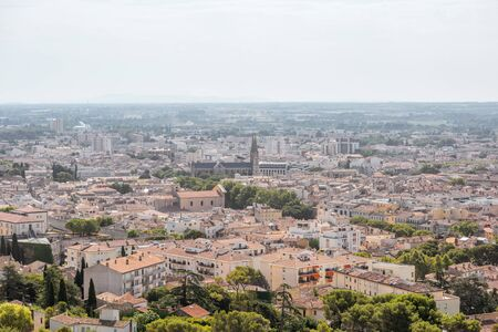 Photo for Aerial cityscape view from Magne tower on the old town of Nimes city in southern France - Royalty Free Image