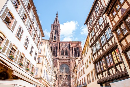 Photo for Street view from below on the beautiful old buildings and Notre-Dame cathedral in Strasbourg city, France - Royalty Free Image