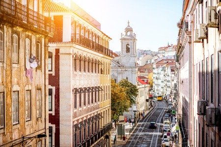 Photo pour Street view with beautiful buildings in the old town of Lisbon city, Portugal - image libre de droit