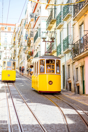 Foto de Street view with famous yellow funicular tram in Lisbon during the sunny day in Portugal - Imagen libre de derechos