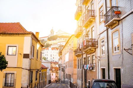 Photo pour Beautiful street view with beautiful residential buildings in Mouraria district during the morning light in Lisbon city, Portugal - image libre de droit