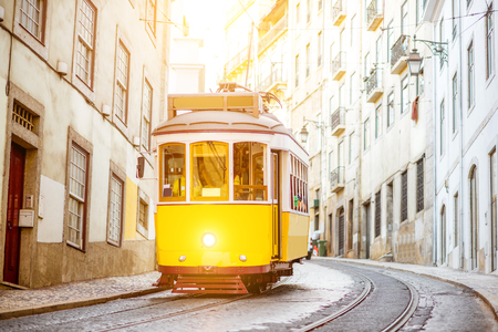 Foto de Street view with famous old tourist tram during the sunny day in Lisbon city, Portugal - Imagen libre de derechos