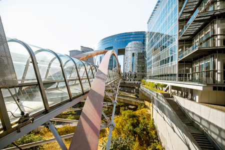 Photo for View on the modern pedestrian bridge in La Defense financial district in Paris - Royalty Free Image