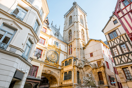 Photo pour Street view with ancient buildings and Great clock on renaissance arch, famous astronomical clock in Rouen, the capital of Normandy region - image libre de droit