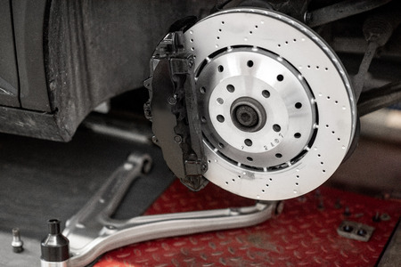 Photo for Disk of a luxury sports car at the car service - Royalty Free Image