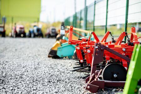 Photo pour New plows for farming on the open ground of agricultural shop - image libre de droit