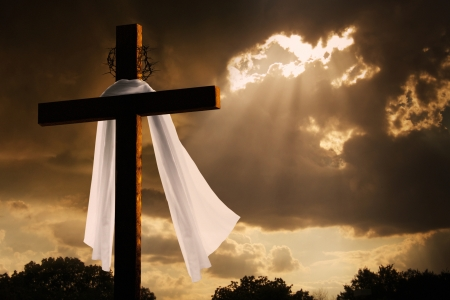 This dramatic lighting with storm clouds breaking and sunshine bursting through makes a great Easter photo illustration of Jesus dying on the cross and rising again